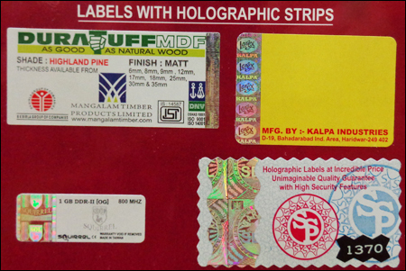 Labels With Holographic Strips
