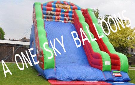 Kids Playing Mega Slide Bouncy