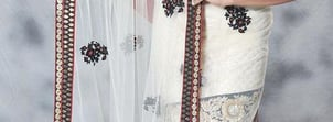 White Net Saree With Contrat Red Frilled Skirt