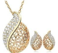 Gold Plated Studded Pendant With Matching Earrings