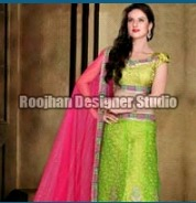 Green And Pink Color Net Lehenga Choli