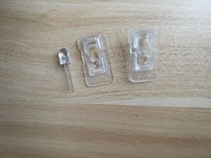 Invisible IR LED and lens use for wireless mouse