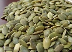 Peeled And Unpeeled Pumpkin Seeds