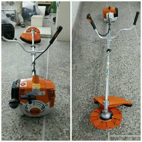 Orange Stihl Grass Cutting Machine