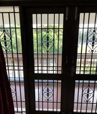 Ornament Design Iron Window Grill