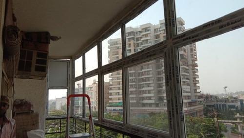 White Modern Balcony Covering Windows