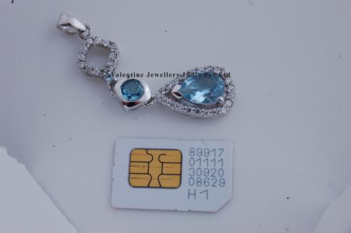 Designer Silver Long Pendant In Blue Topaz And Cz
