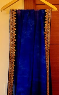 Blue Tie And Dye Chiffon Saree With Golden Aari And Sequin Work On Blue Velvet Border