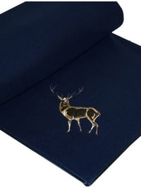 Fleece rug with embroidered stag motif