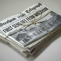 Over Issued Newspaper Scraps