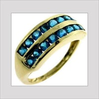 GOLD RING WITH STUDDED STONE