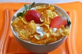 Cornflakes With Milk Pouring