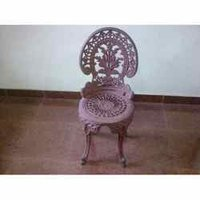 Ethnic Cast Iron Chairs