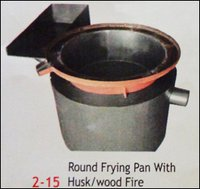 Round Frying Pan With Husk And Wood Fire