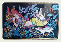 A Girl Lying On Land With With Hand Made Mayuri Painting