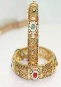 Polki Bangles With Beautiful Golden Chain Work, Red And Green Stone