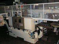 MW-16 II Twin Spindle Super-Precision CNC Chucker with Gantry Loader/Un-Loader