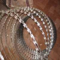 Concertina razor coil