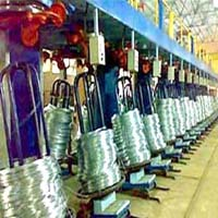 Vertical drop coiler
